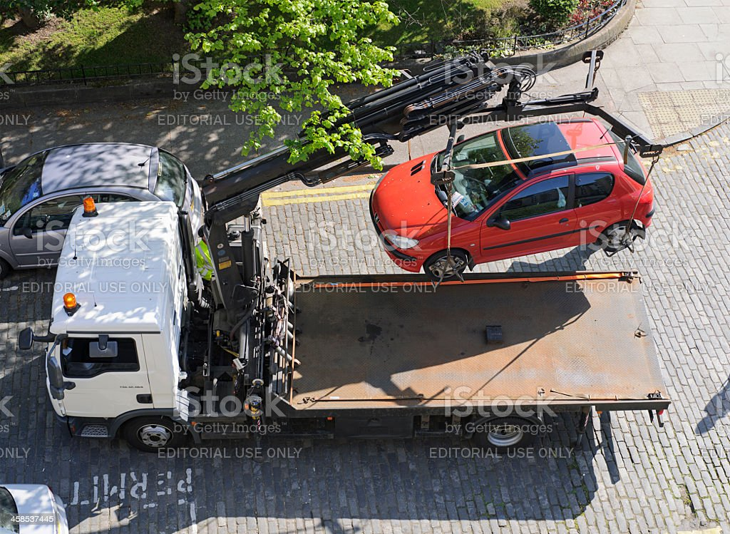 Car Being Lifted Following Parking Offense stock photo