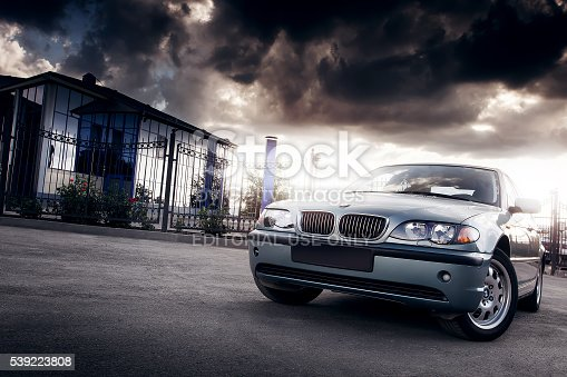 Saratov, Russia - August 20, 2014 - Car BMW E46 stay in the city near mirror building at cloudy sunset