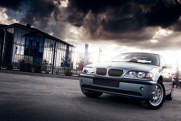 Car BMW E46 stay in the city at sunset stock photo