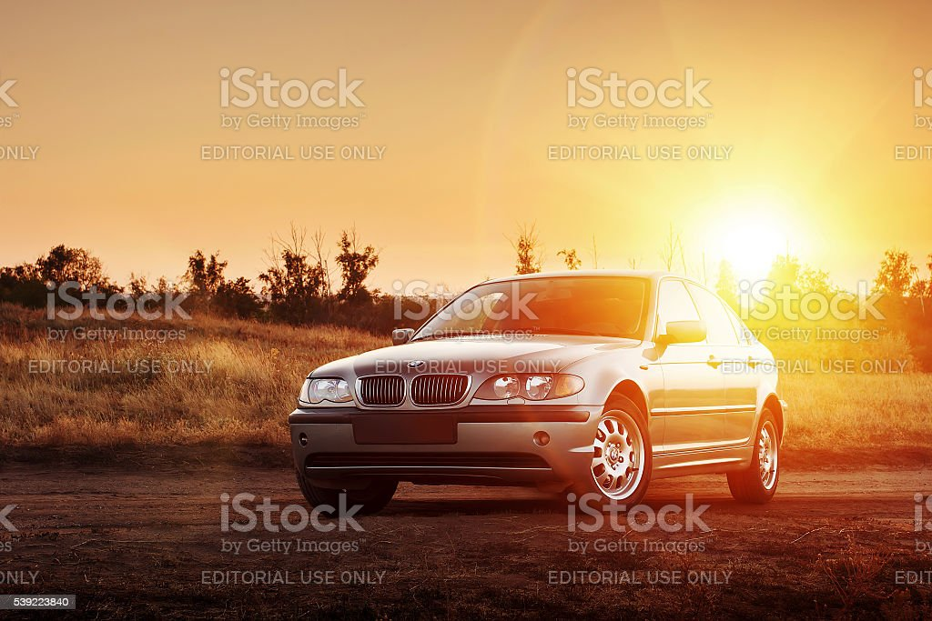 Car BMW E46 stay on countryside road at sunset Saratov, Russia - August 20, 2014 - Car BMW E46 standing at countryside dirt road at sunset BMW Stock Photo