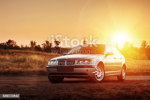 Saratov, Russia - August 20, 2014 - Car BMW E46 standing at countryside dirt road at sunset