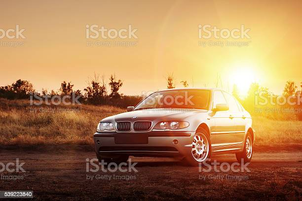 Car Bmw E46 Stay On Countryside Road At Sunset Stock Photo - Download Image Now