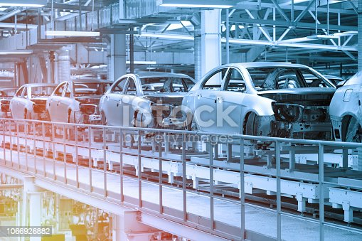 istock Car bodies are on Assembly line. Factory for production of cars in blue. Modern automotive industry. Blue tone 1066926882