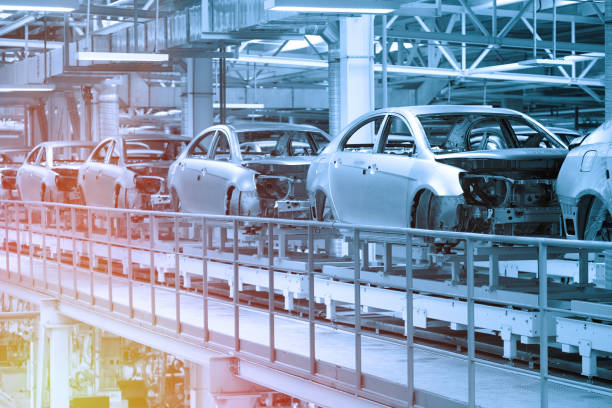Car bodies are on Assembly line. Factory for production of cars in blue. Modern automotive industry. Blue tone stock photo