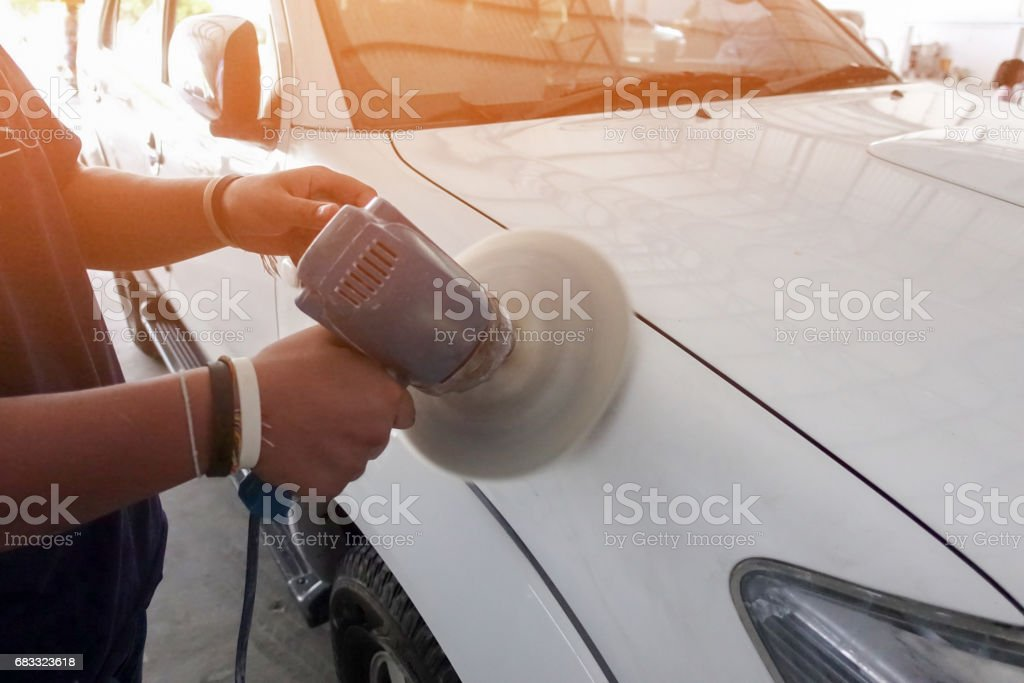 Car body color polishing by electric drill foto stock royalty-free