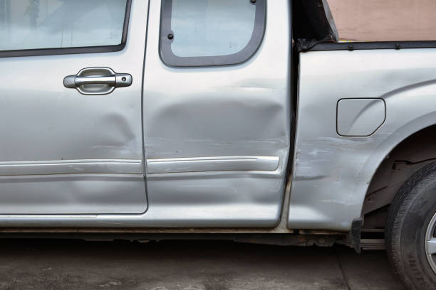 car body side damage after an road traffic accident, close- up - dent stock pictures, royalty-free photos & images