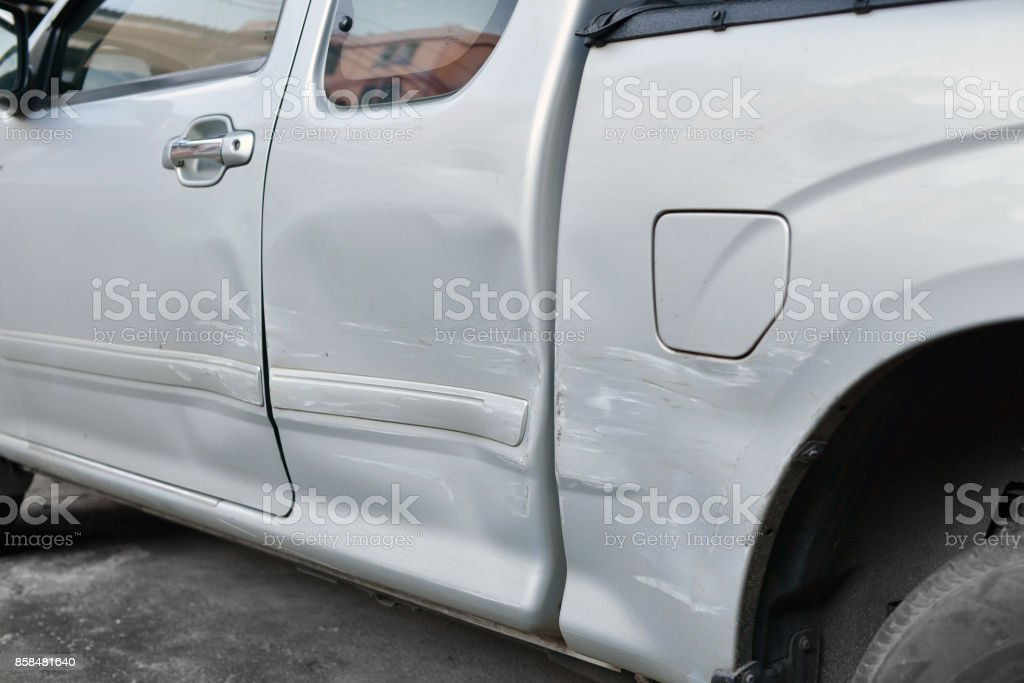 Car body side damage after an road traffic accident, close- up stock photo
