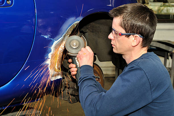 car body worker. - auto body repair stock photos and pictures