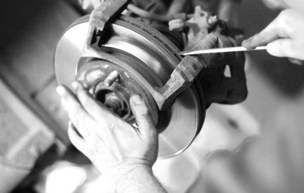 car brake disc - brake service stock photos and pictures