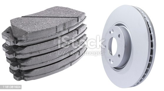 Car Brake discs and brake pads isolated on white background. Auto parts. Brake disc rotor isolated on white. Braking disk. Car part. Car detailing. Spare parts