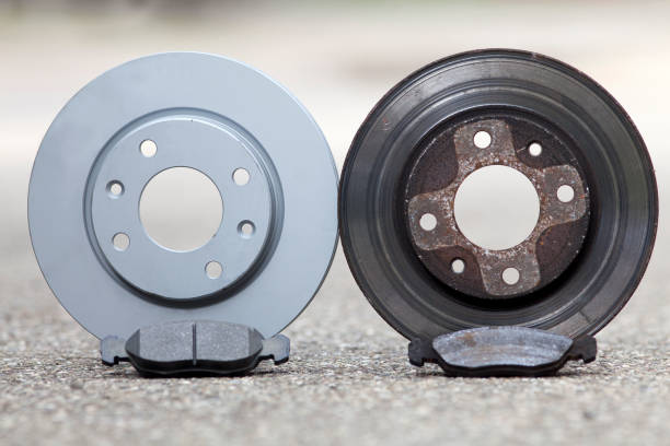 car brake disk and pad. old used and new to change for safety stock photo