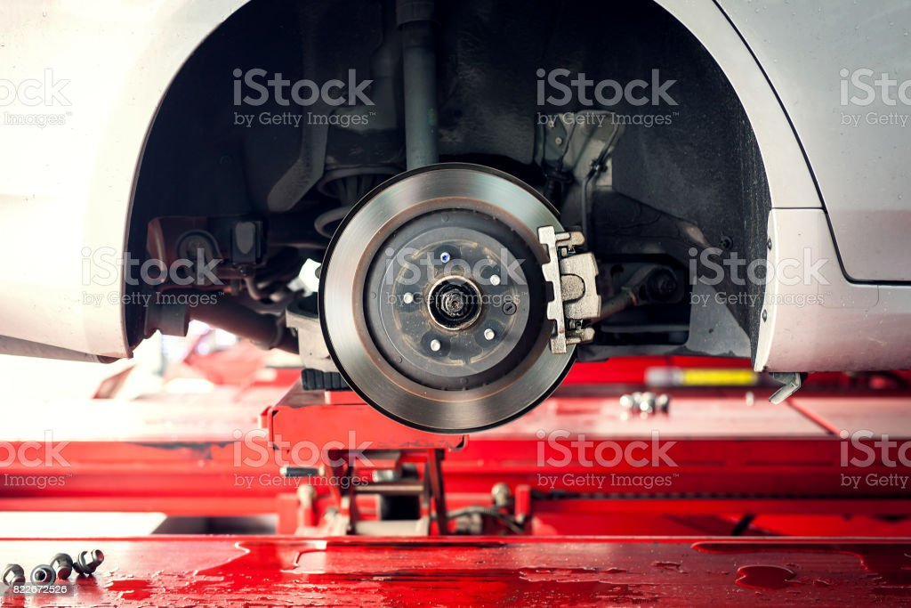 car brake part at garge, car brake disc without wheels closeup stock photo