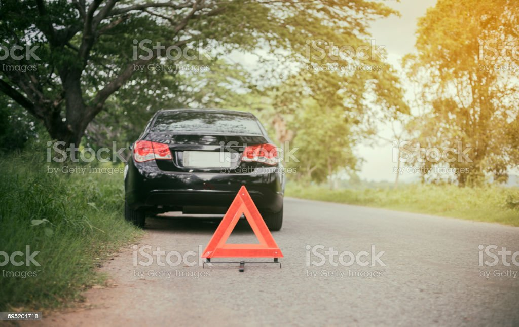 A car breakdown with Red triangle of a car on the road stock photo