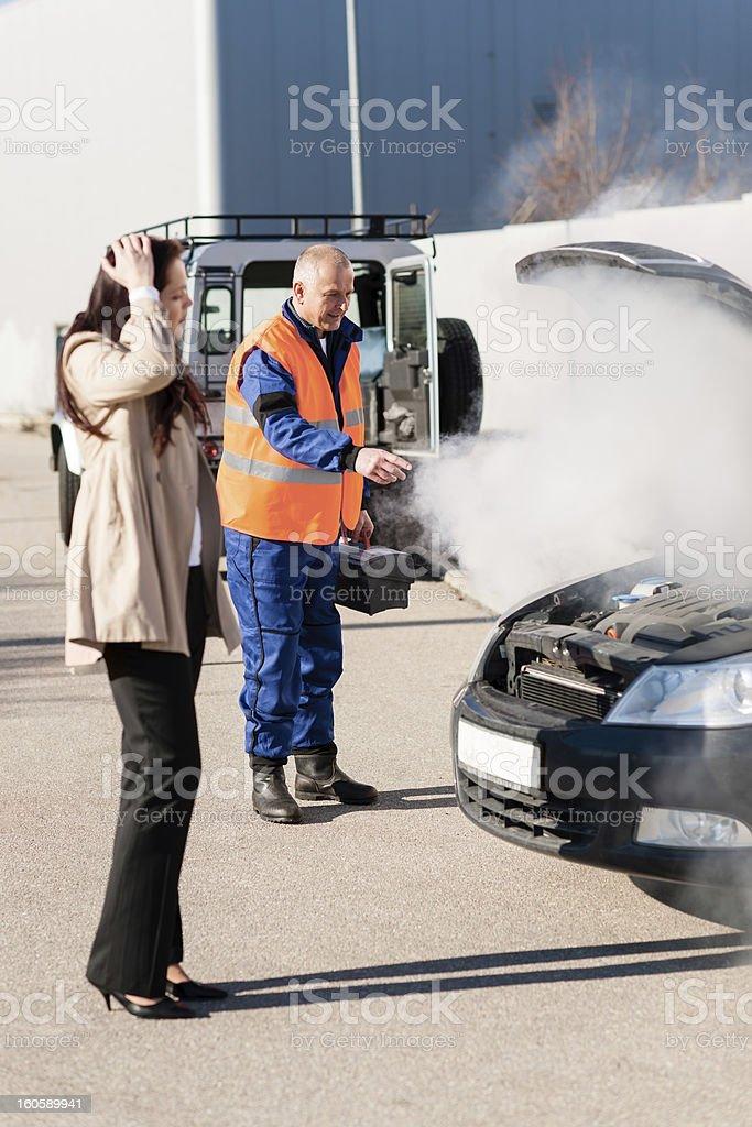 Car breakdown woman get help road-assistance man royalty-free stock photo