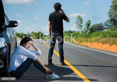 istock Car broken street Man telephone call insurance. She had a stress 855327600