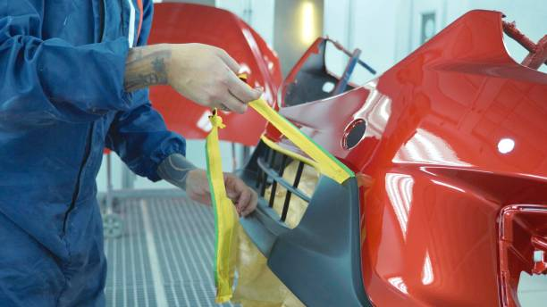 car bumper after painting in a cars spray booth. auto vehicle primer bumper. - auto body repair stock photos and pictures