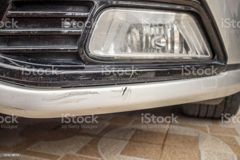 Car Bumper Scratched Paint Damage Stock Photo - Download