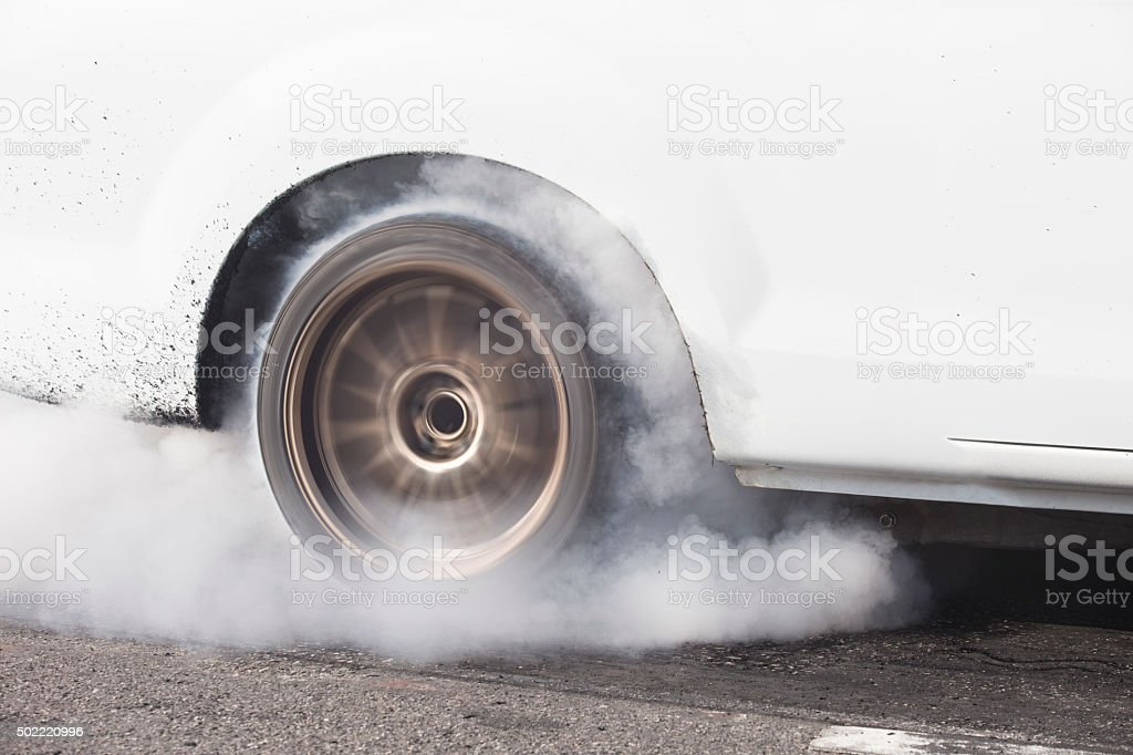 car burns rubber for the race stock photo