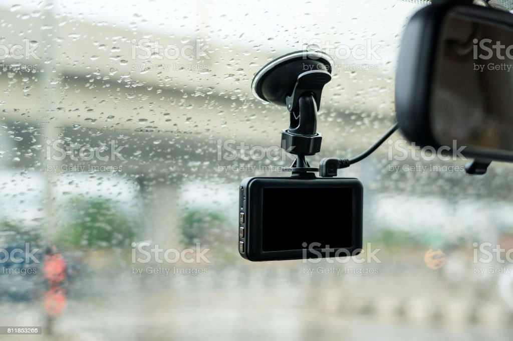 Car camera installed on a windshield. stock photo