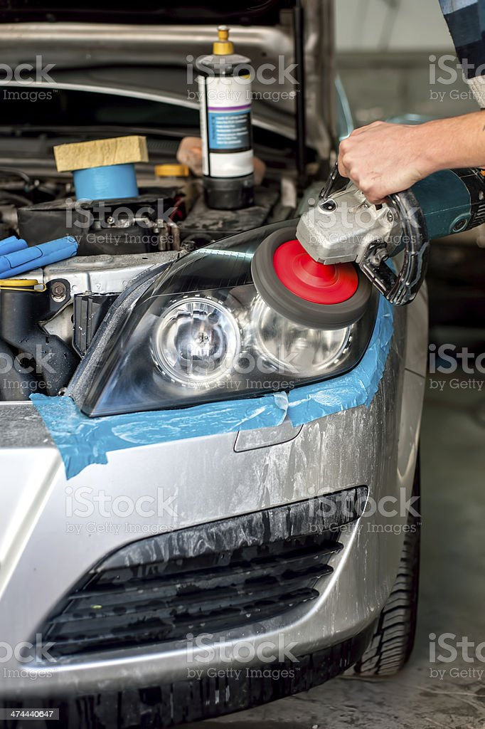 Car Care headlight cleaning with power buffer machine royalty-free stock photo