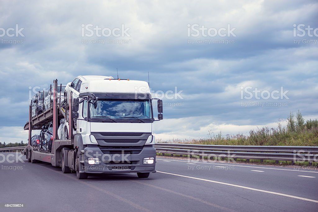 Car carrier on the highway. stock photo