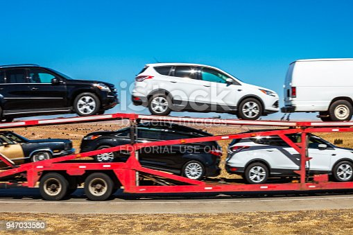 Gray County, Texas, USA - February 17, 2014: Car carrier trailer on interstate in Texas not far from Oklahoma state.