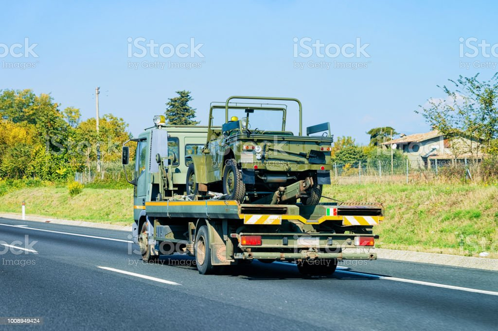 Car carrier truck in road stock photo
