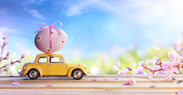 car carrying easter egg - easter foto e immagini stock