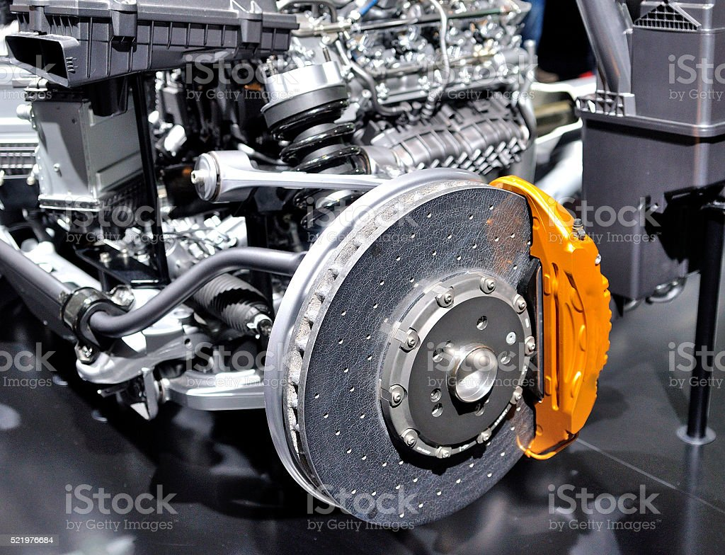 Car ceramic disc brake with yellow caliper. stock photo