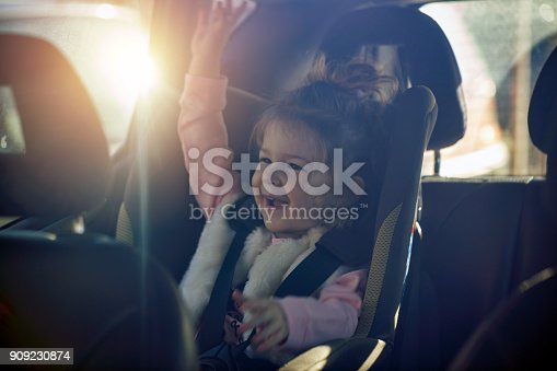 istock car child seat- happy girl in her car seat 909230874