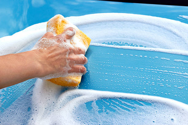 Car cleaning With Sponge And Soap stock photo
