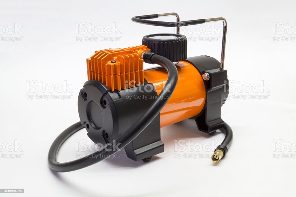 Car compressor on light background stock photo