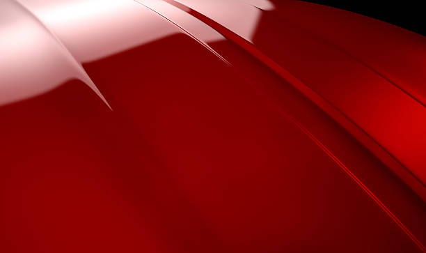 Car Contour Cherry Red An abstract section of the contours of a cherry red automobile bonnet with dramatic lighting on a dark studio background vehicle hood stock pictures, royalty-free photos & images