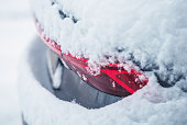 istock Car Covered by Fresh Winter Snow 1299799122