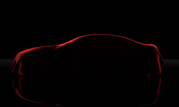 car covered with a red cloth isolated on a black background - coprire foto e immagini stock