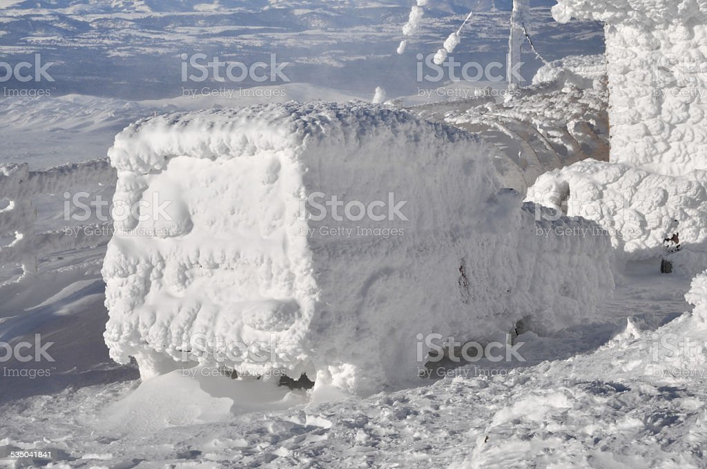 Car covered with snow at winter stock photo