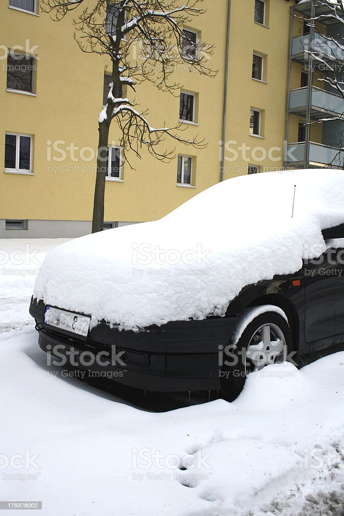 car covered with snow in winter royalty-free stock photo