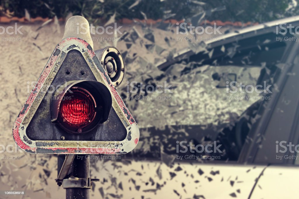 Car crash accident, hitting to the wall with high speed. Red traffic light siren warning. Broken car glass pieces. stock photo