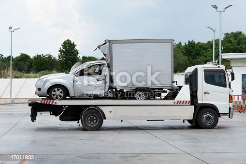 istock car crash accident on car Towing Truck . And moving to the truck for repair 1147011933