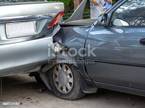 Car crash accident on street with wreck and damaged automobiles. Accident caused by negligence And lack of ability to drive. Due to illness