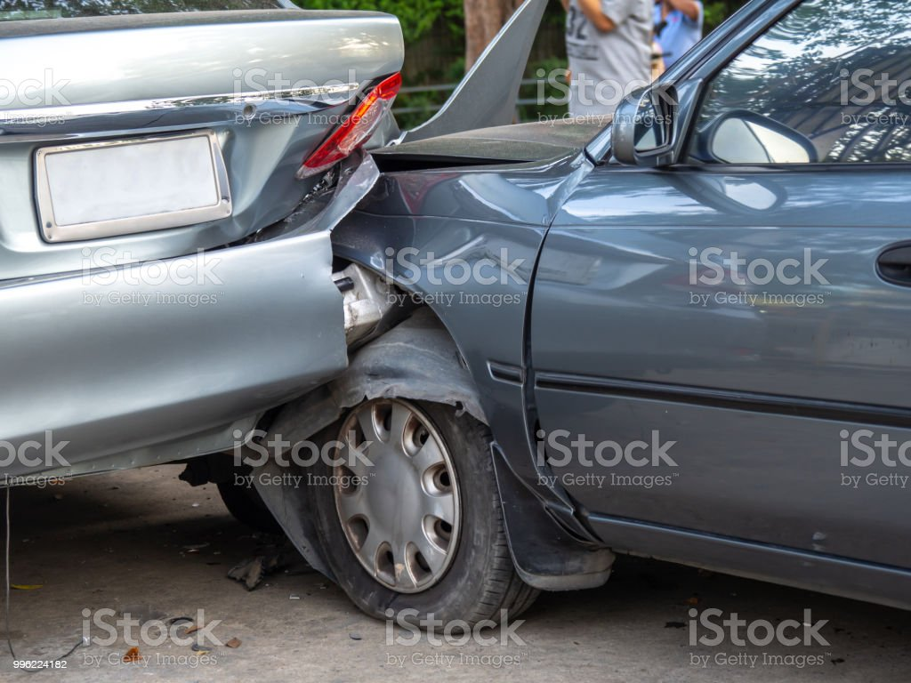 Car crash accident on street with wreck and damaged automobiles. Accident caused by negligence And lack of ability to drive. Due to illness stock photo