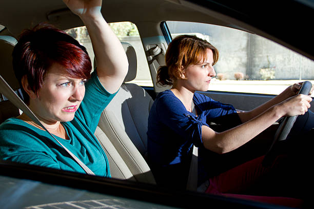 Car Crash Accident with a Female Driver and Passenger Bracing stock photo