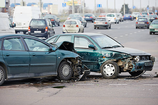 car crash collision in urban street - car accident stock photos and pictures