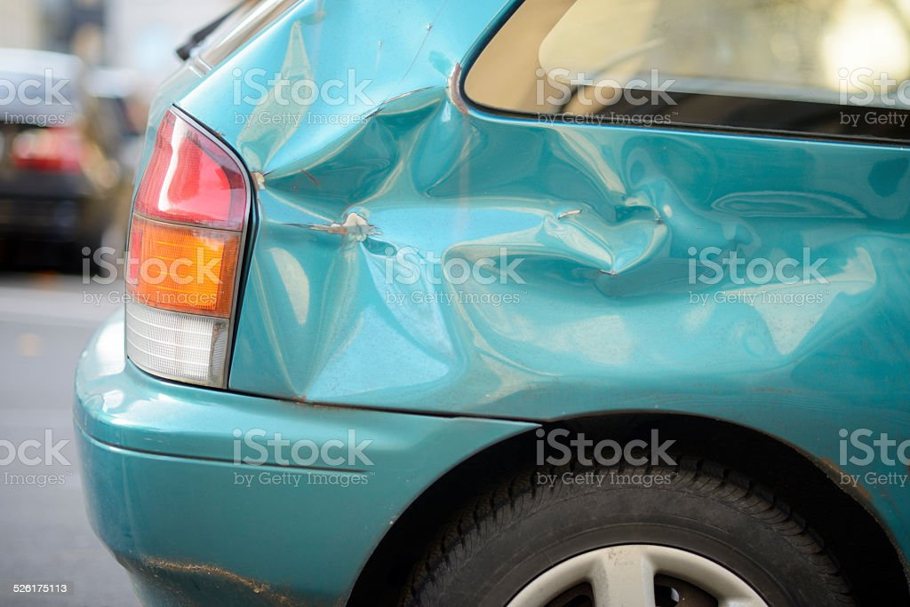 Car crash / dented metal sheet stock photo
