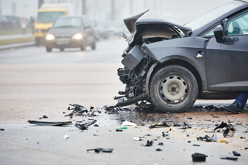 istock Car crash in urban street with black car 466327320