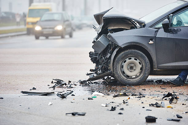 Car crash in urban street with black car car crash accident on street, damaged automobiles after collision in city crash stock pictures, royalty-free photos & images