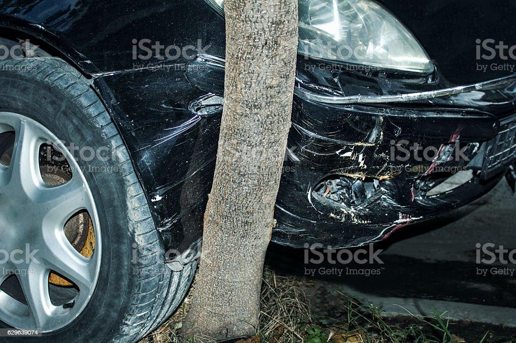 Car crashed, head on into a tree near the road stock photo