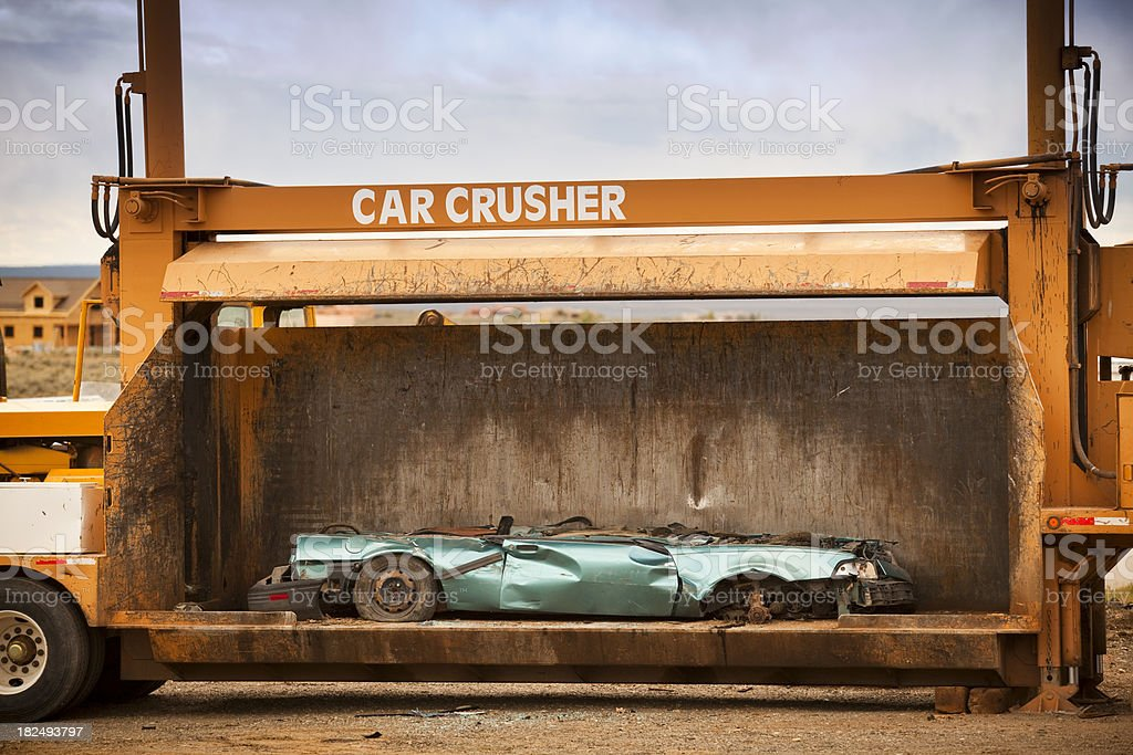 Car crushing machine stock photo