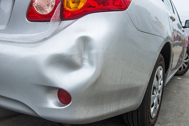 Car damaged A car has a dented rear bumper after an accident bumper stock pictures, royalty-free photos & images