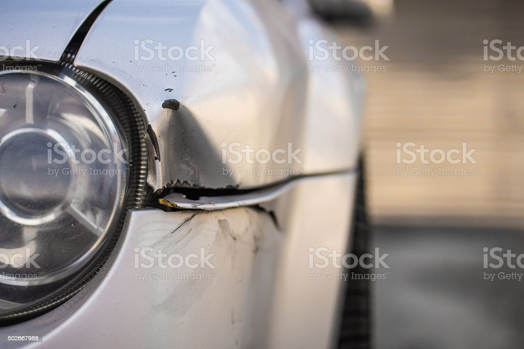 Car damged and dented in an accident stock photo